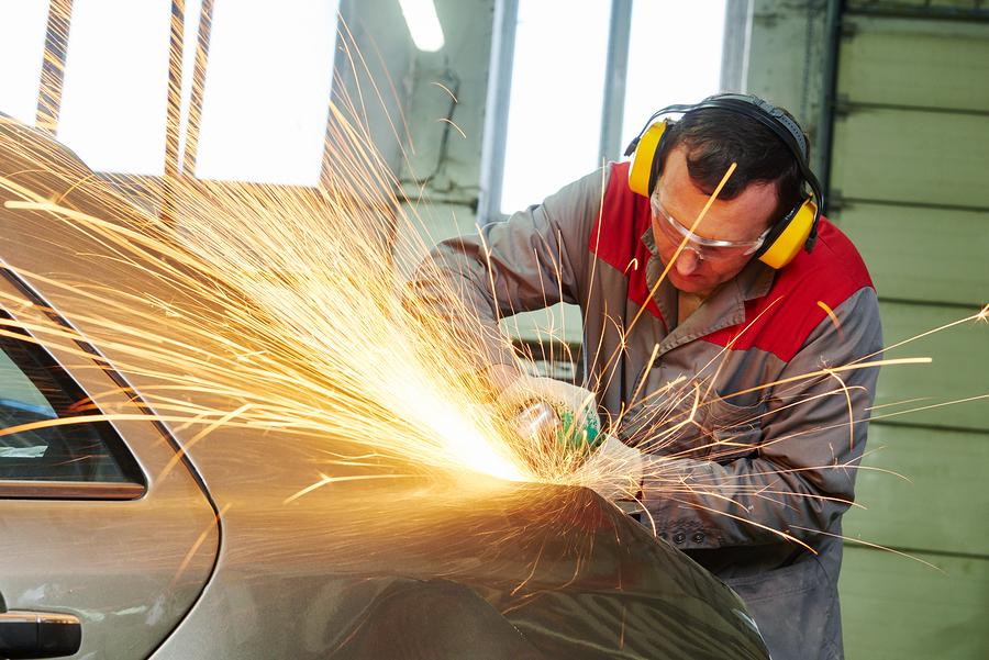 professional auto mechanic expert doing collision repair